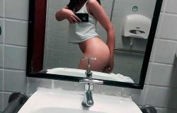 Sexy girl masturbating in the bathroom of college